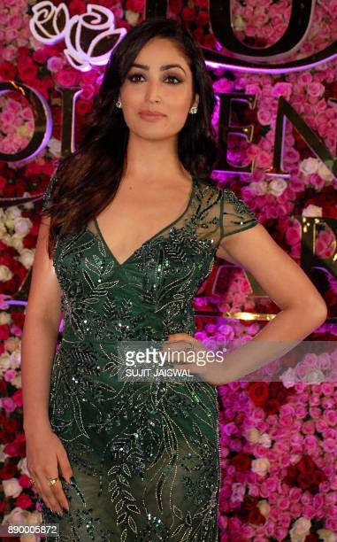 Indian Bollywood actress Yami Gautam poses for a photograph during a promotional event in Mumbai on late December 10 2017 / AFP PHOTO / Sujit Jaiswal