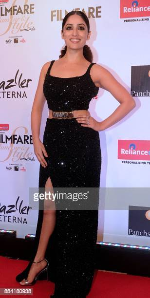 Indian Bollywood actress Yami Gautam poses for a photograph during the Filmfare Glamour Style Awards 2017 in Mumbai on December 1 2017 / AFP PHOTO /