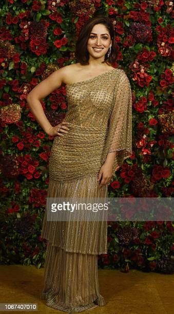 Indian Bollywood actress Yami Gautam poses for a picture during the wedding reception party of actors Ranveer Singh and Deepika Padukone in Mumbai...