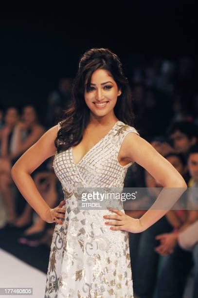 Indian Bollywood actress Yami Gautam showcases a creation by designer Ranna Gill during a fashion show on the first day of the Lakme Fashion Week...