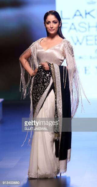 Indian Bollywood actress Yami Gautam showcases a creation by designer Manish Malhotra at the Lakmé Fashion Week Summer Resort 2018 in Mumbai on...