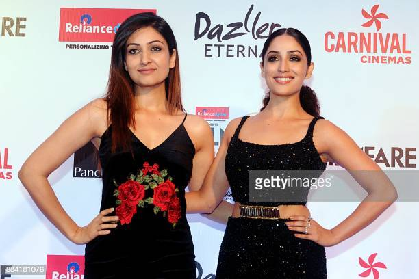 Indian Bollywood actress Yami Gautm and her sister Surilie Gautam pose for a photograph during the Filmfare Glamour Style Awards 2017 in Mumbai on...