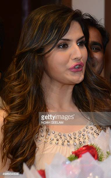 Indian Bollywood actress Zarine Khan looks on during a promotional event for the forthcoming Hindi film 'Hate Story 3' in Hyderabad on November 27...