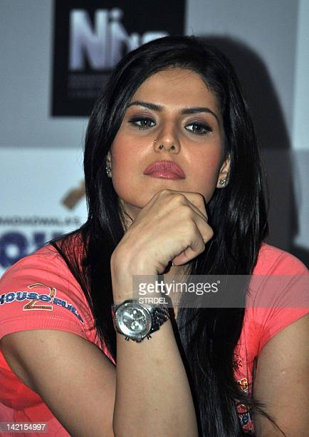 """Indian Bollywood actress Zarine Khan looks on during the promotion for the forthcoming Hindi film """"Housefull 2"""" in Mumbai late March 30 2012 AFP..."""