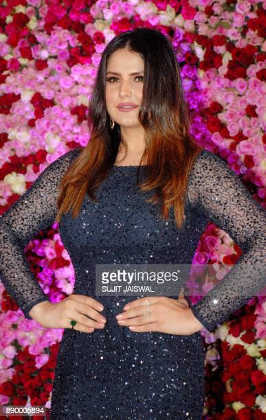 Indian Bollywood actress Zarine Khan poses for a photograph during a promotional event in Mumbai on late December 10 2017 / AFP PHOTO / Sujit Jaiswal