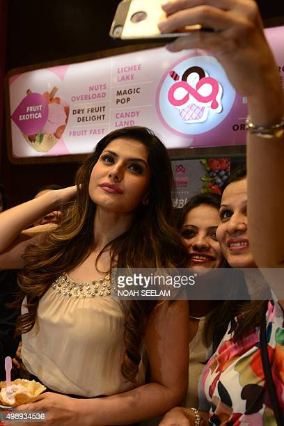 Indian Bollywood actress Zarine Khan poses for a 'selfie' with fans during a promotional event for the forthcoming Hindi film 'Hate Story 3' in...