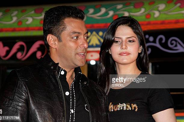 """Indian Bollywood actress Zarine Khan poses with actor Salman Khan during a music launch ceremony for the forthcoming Hindi comedy film """"Ready""""..."""