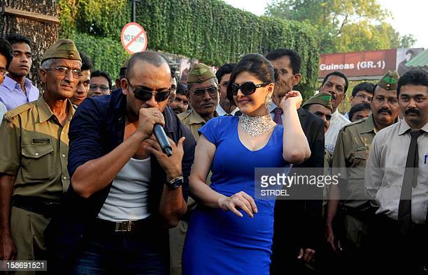 Indian Bollywood actress Zarine Khan poses with pop singer Ali Quli Mirza as she attends 'The Gitanjali Derby' at a racecourse in Mumbai on December...