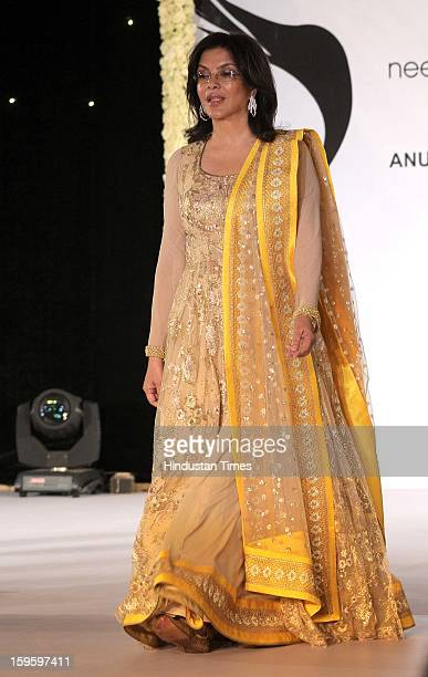 Indian bollywood actress Zeenat Aman walk on the ramp during the Beti Fashion Show 2013 was organized by the ITA for acid and rape victims at JW...