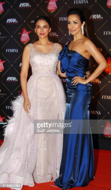 Indian Bollywood actresses Aditi Rao Hydari and Malaika Arora pose for a picture during the 'Femina Beauty Awards 2018' in Mumbai late on February...