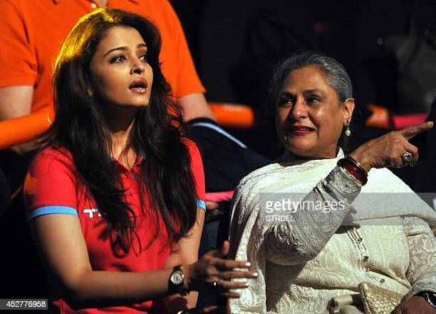 Indian Bollywood actresses Aishwarya Rai Bachchan and Jaya Bachchan look on during a professional kabaddi league match in Mumbai on late July 26 2014...