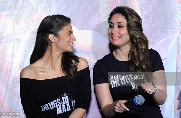 Indian Bollywood actresses Alia Bhattand Kareena Kapoor Khan pose during the trailer launch of the forthcoming Hindi film Udta Punjab written and...
