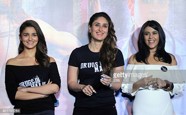 Indian Bollywood actresses Alia Bhattand Kareena Kapoor Khan pose with producer Ekta Kapoorduring the trailer launch of the forthcoming Hindi film...