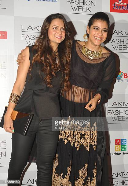 Indian Bollywood actresses Amrita Arora and Kajol Devgan attend the Lakme Fashion Week Winter/Festival 2013 in Mumbai on August 22 2013 AFP PHOTO/STR