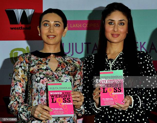 Indian Bollywood actresses and sisters Karishma Kapoor and Kareena Kapoor attend the Women and the Weight Loss Tamasha book launch in Mumbai on...