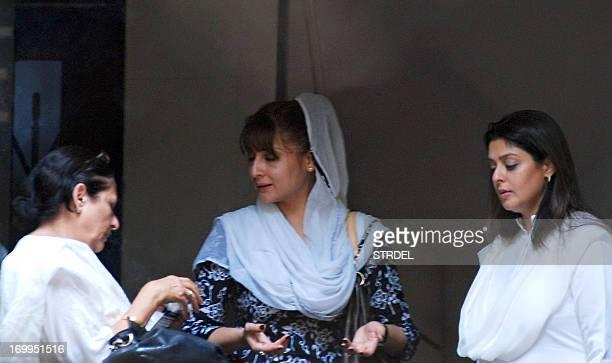Indian Bollywood actresses Anju Mahendru Urvashi Dholakia and Nagma attend the funeral of Indian Bollywood actress Jiah Khan in Mumbai on June 5 2013...