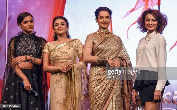 Indian Bollywood actresses Ankita Lokhande Misthi Kangana Ranaut and Unnati Davara pose for photographs the music launch of the upcoming Hindi film...