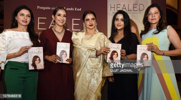 Indian Bollywood actresses Bhagyashree Rekha Aditi Govitrikar and singer Amruta Fadnavis pose for a picture as they attend the book launch of...