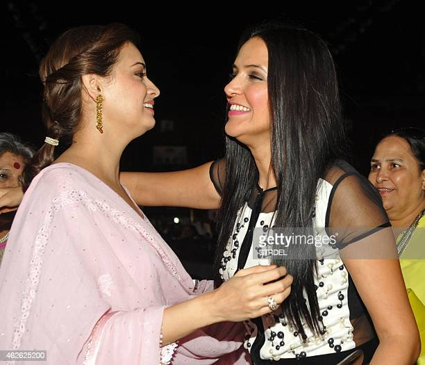 Indian Bollywood actresses Dia Mirza and Neha Dhupia hug as they attend an event organised by the Rotary Club of Bombay in Mumbai on February 1 2015...