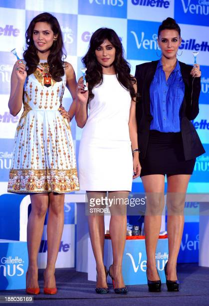 Indian Bollywood actresses Esha Gupta, Chitrangada Singh and Neha Dhupia pose during the launch of Gillette shaving system 'designed especially for...