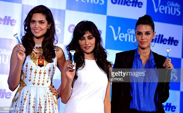 Indian Bollywood actresses Esha Gupta Chitrangada Singh and Neha Dhupia pose during the launch of Gillette shaving system 'designed especially for...
