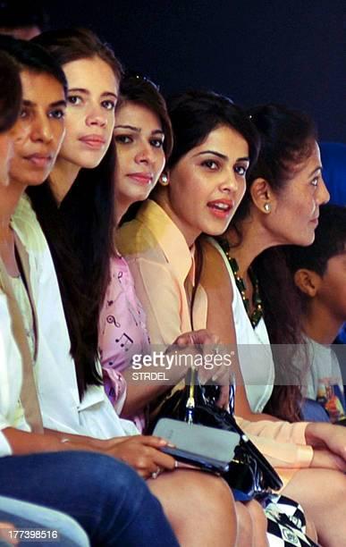 Indian Bollywood actresses Kalki KoechlinTanisha Mukherjee and Genelia D'Souza attend the Lakme Fashion Week Winter/Festival 2013 in Mumbai on August...