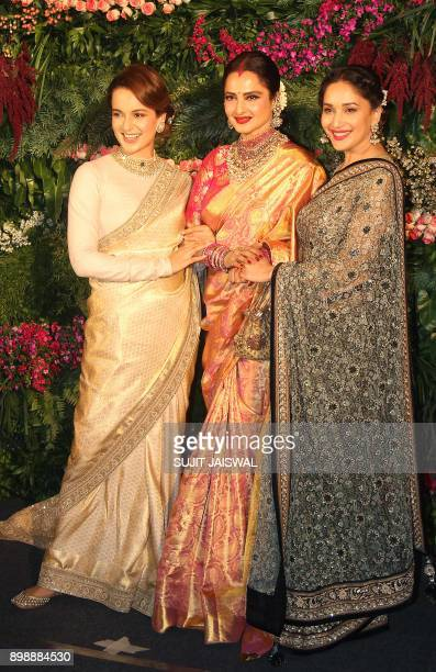 Indian Bollywood actresses Kangana Ranaut Rekha and Madhuri Dixit Nene pose for a photograph during the wedding reception of the Bollywood actress...