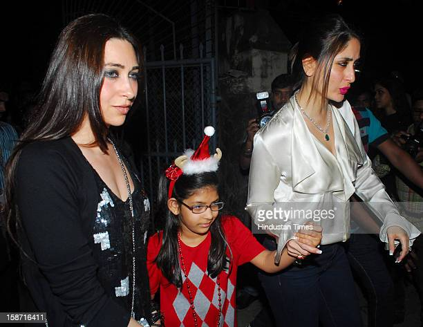 Indian bollywood actresses Kareena Kapoor and Karisma Kapoor with her daughter came out to St Andrews Church in Bandra for Christmas celebrations on...