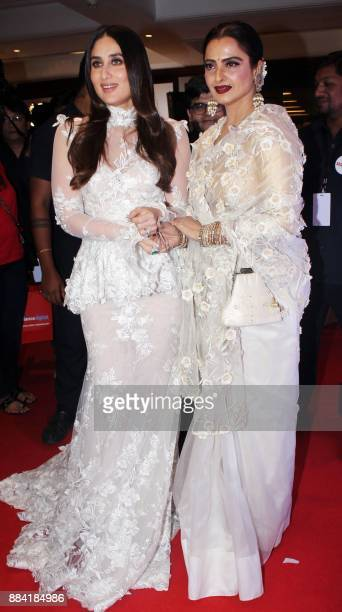 Indian Bollywood actresses Kareena Kapoor Khan and Rekha pose for a photograph during the Filmfare Glamour Style Awards 2017 in Mumbai on December 1...
