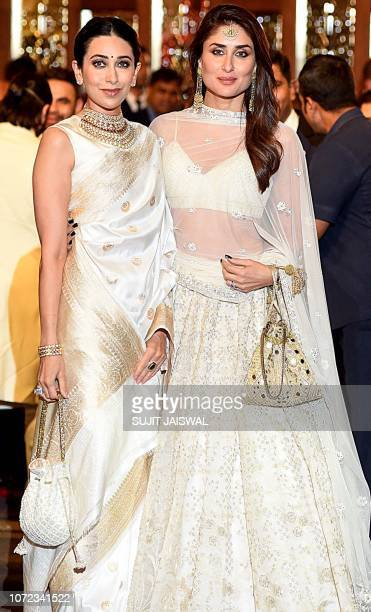 Indian Bollywood actresses Karishma Kapoor and Kareena Kapoor Khan attend the wedding of Indian businesswoman Isha Ambani with Indian businessman...