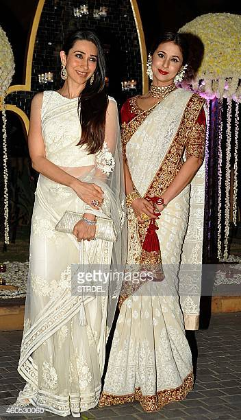Indian Bollywood actresses Karishma Kapoor and Urmila Matondkar attend the wedding reception of Bollywood film director Punit Malhotra and Riddhi...