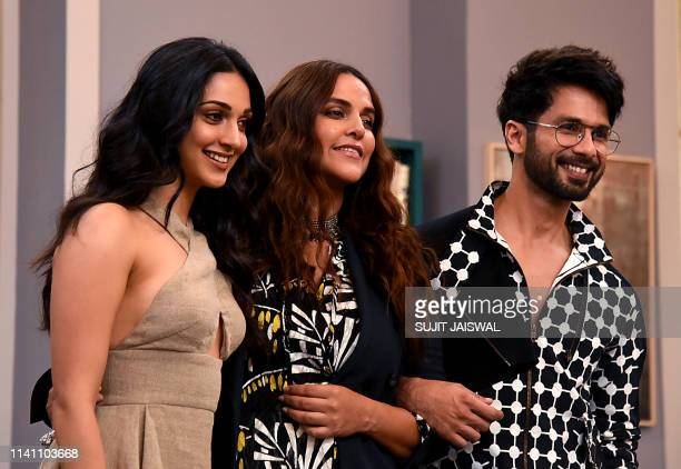 Indian Bollywood actresses Kiara Advani , Neha Dhupia and actor Shahid Kapoor pose for photographs during the recording of the reality talk show...
