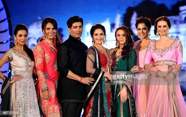 Indian Bollywood actresses Malaika Arora Khan Lara DuttaMadhuri Dixit Nene Preity Zinta Isha Koppikar and Evelyn Sharma pose as they display...