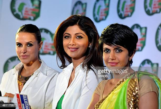Indian Bollywood actresses Neha Dhupia Shilpa Shetty and Mandira Bedi pose for a photograph during a promotional event in Mumbai on January 8 2015...