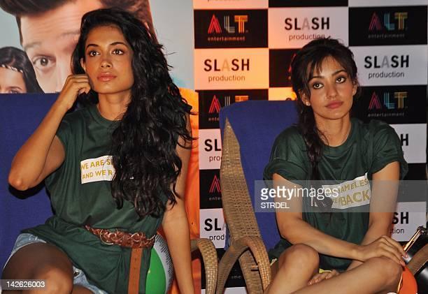 "Indian Bollywood actresses Neha Sharma and Sarah Jane Dias pose during a promotional event for the forthcoming Hindi film ""Kyaa Super Kool Hai Hum""..."