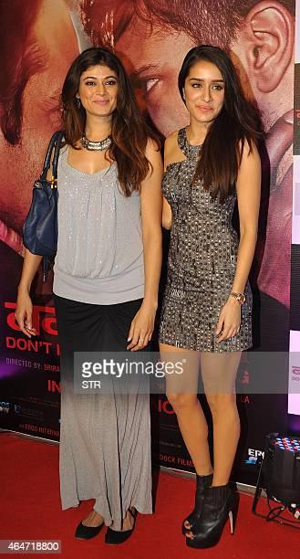 Indian Bollywood actresses Pooja Batra and Shraddha Kapoor attend the Success Party of Hindi film 'Badlapur' directed by Sriram Raghavan in Mumbai on...