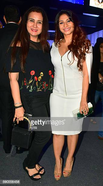 Indian Bollywood actresses Poonam Dhillon and Tanisha Mukherjee pose as they attend the launch of Admantino at Joya Exhibition in Mumbai late August...
