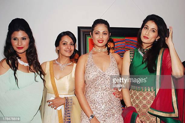 Indian Bollywood actresses Ritu Jhangiani Anita Hasnandani Anjana Sukhani and Sagarika Ghatge pose as they attend the Amanaya Art and Sagar Samir...