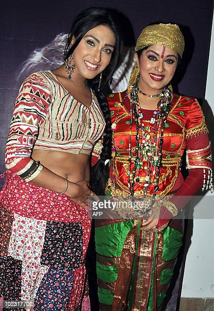 Indian bollywood actresses Rituparna Sengupta and Sudha Chandran pose during an event celebrating the 150th anniversary of Kabiguru Rabindranath...