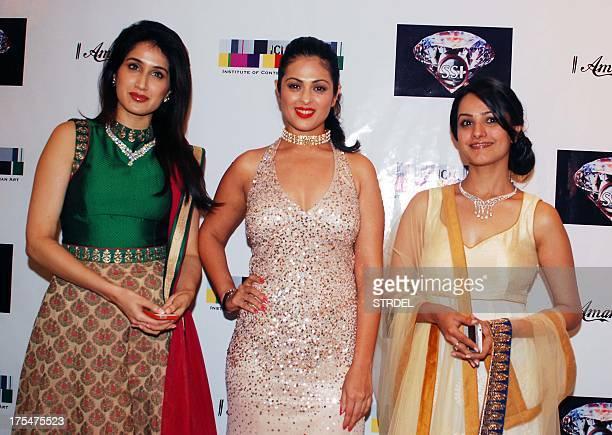 Indian Bollywood actresses Sagarika Ghatge Anjana Sukhani Anita Hasnandani pose as they attend the Amanaya Art and Sagar Samir International...
