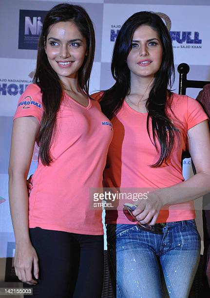 """Indian Bollywood actresses Shazahn Padmsee and Zarine Khan pose during the promotion for the forthcoming Hindi film """"Housefull 2"""" in Mumbai late..."""