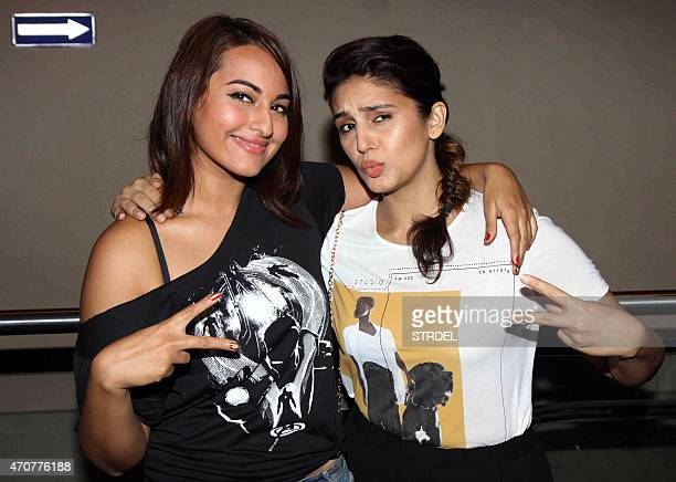 Indian Bollywood actresses Sonakshi Sinha and Huma Qureshi pose for a photograph during a screening of Hollywood film 'Avengers Age of Ultron' in...