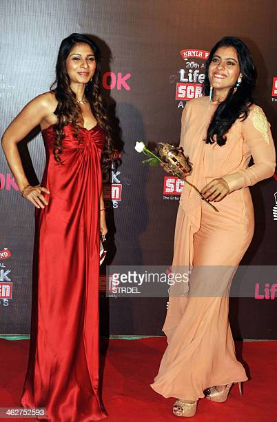 Indian Bollywood actresses Tanisha Mukherjee and Kajol Devgn pose for a photograph during the Life OK Screen Awards 2014 ceremony in Mumbai on late...