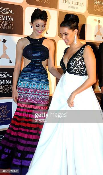Indian Bollywood actresses Urvashi Rautela and Neha Dhupia share a light moment as they attend LOreal Paris Femina Women Awards 2015 ceremony in...