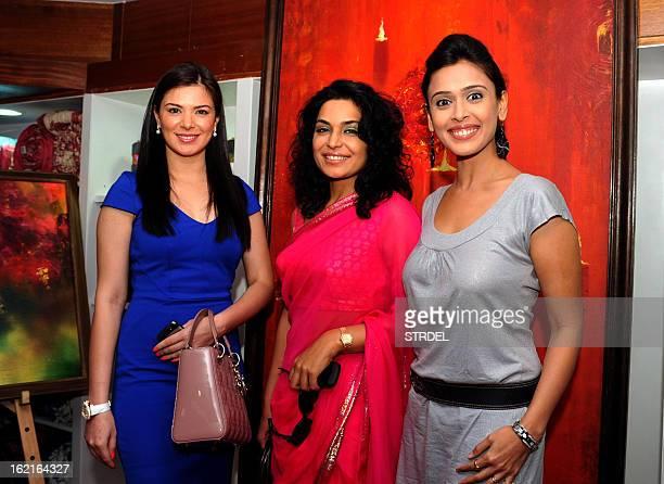 Indian Bollywood actresses Urvashi Sharma Hrishtaa Bhatt and Pakistani actress Meera pose for a photo during the Amisha Mehta's art show 'Colour...