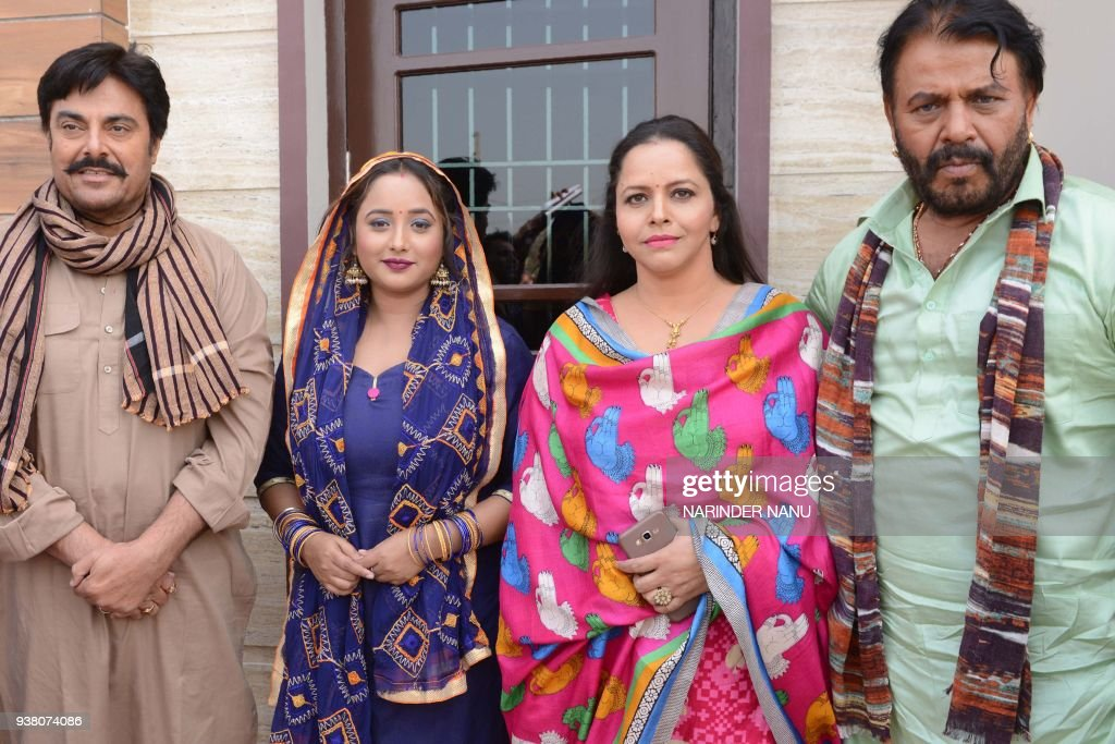Indian Bollywood and Punjabi actors Tinu Varma Guggu Gill actresses Rani Chatterjee and Seema Sharma pose during the filming on the set of the...