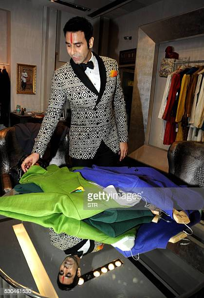 Indian Bollywood choreographer and ballroom dancer Sandip Soparrkar selects clothing designed by Pooja Shah ahead of his visit to the Cannes Film...