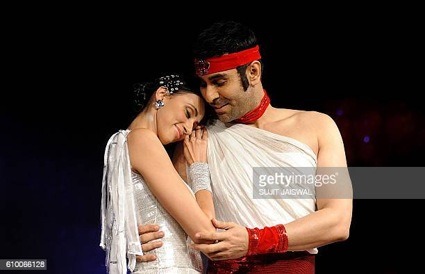 Indian Bollywood choreographer and ballroom dancer Sandip Soparrkar dances with model Alesia Raut during the performance of the dancedrama'Born to...