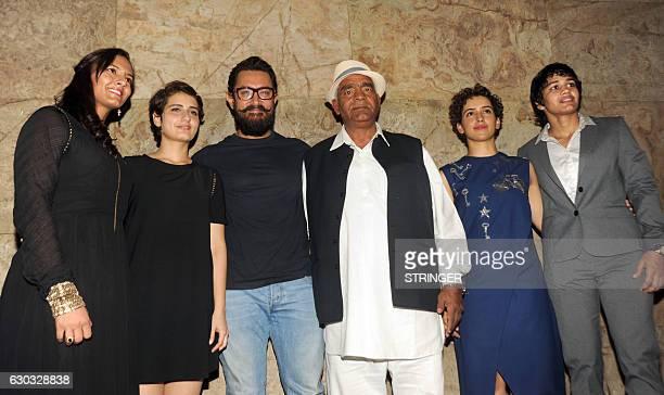 Indian Bollywood ctor Aamir Khan with cast members Fatima Sana Shaikh Sanya Malhotra and Indian amateur wrestler and Olympic coach Mahavir Singh...