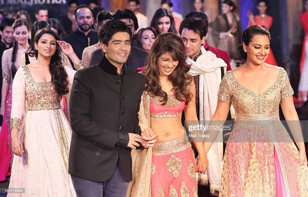 Indian Bollywood designer Manish Malhotra walks the ramp Priyanka Chopra and Sonakshi Sinha during Shabana Azmi`s charity fundraising fashion show...
